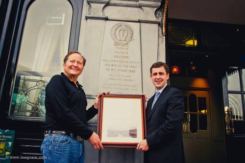 Senator Mark Daly presenting former Governor of Montana, Brian Schweitzer, with a certificate of Irish Heritage in Waterford on his last visit to Ireland